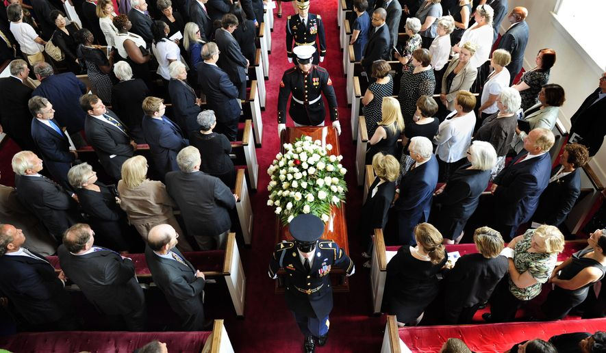 A military honor guard escorts the casket of Sen. Robert Byrd, Tuesday, July 6, 2010, after a funeral service at the Memorial Baptist Church in Arlington, Va. (AP Photo/Linda Davidson, Pool)