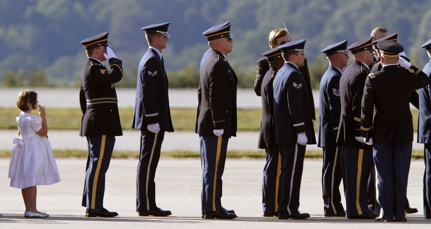 A family member of the late Sen. Robert Byrd, follows the honor guard carrying his casket at it arrived on a West Virginia Air National Guard C-130 transport plane by an honor guard at Yeager Airport in Charleston, W.Va., Thursday, July 1, 2010. Mr. Byrd was being buried at a cemetery in Arlington, Va., on Tuesday, July 6, 2010. (AP Photo/Steve Helber)