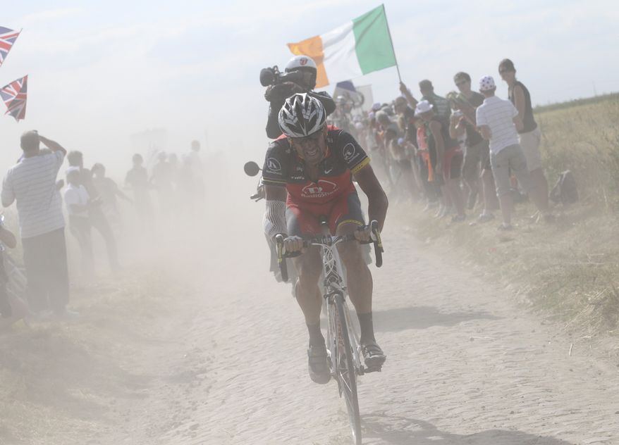 ASSOCIATED PRESS Lance Armstrong  of the US rides in a cloud of dust on a cobblestone section during the third stage of the Tour de France cycling race over 213 kilometers (132.4 miles) with start in Wanze, Belgium and finish in Arenberg, France, Tuesday July 6, 2010.