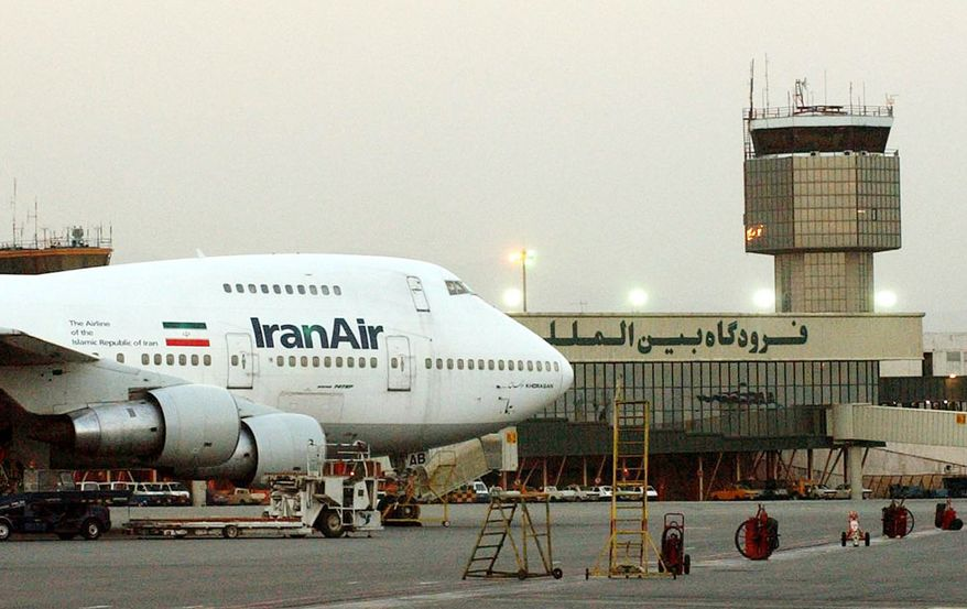 This June 2003 file photo of a Boeing 747 of Iran's national airline Iran Air at Mehrabad International airport in Tehran. The EU on Tuesday, July 6, 2010, banned most of Iran Air's jets from flying to Europe due to safety concerns, emphasizing that the move was not related to U.N. sanctions against Iran over its nuclear program. The 27-nation bloc also relaxed restrictions on two airlines from Indonesia and put a Surinam airline on its blacklist of carriers the EU believes do not meet international safety standards. (AP Photo/Hasan Sarbakhshian, file)