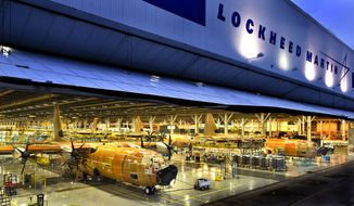 ** FILE ** The first three C-130J Super Hercules aircraft for India take the final positions on Lockheed Martin's assembly line in Marietta, Ga. The initial delivery was scheduled for February 2011. (PRNewsFoto/Lockheed Martin Corp.)