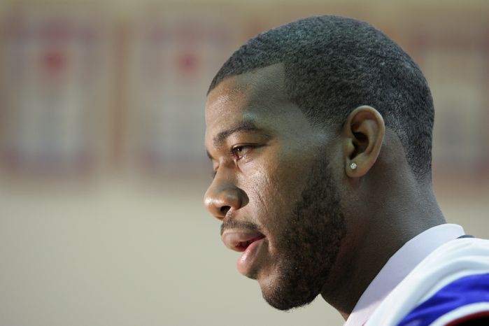 ASSOCIATED PRESS Detroit Pistons draft pick Greg Monroe is interviewed after he was introduced at a news conference, Saturday, June 26, 2010, in Auburn Hills, Mich. Monroe, a 6-foot-11 forward from Georgetown, was the No. 7 pick.