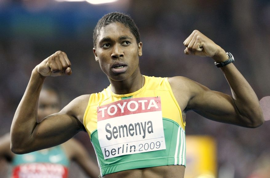 """In this Aug. 19, 2009, file photo, South Africa's Caster Semenya celebrates after winning the gold medal in the final of the Women's 800m at the World Athletics Championships in Berlin. Semenya has been cleared to return to competitive athletics by the IAAF with immediate effect. Athletics' world governing body gave Semenya the go-ahead to compete again in a statement Tuesday July 6, 2010, saying """"the IAAF accepts the conclusion of a panel of medical experts that she can compete with immediate effect."""" (AP Photo/Anja Niedringhaus, File)"""