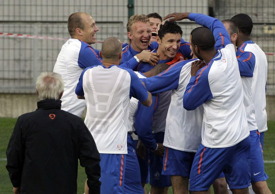 Dutch players joke during a team training session of the Netherlands in Cape Town, South Africa, Monday, July 5, 2010. On Tuesday the Netherlands play the semifinal against Uruguay at the soccer World Cup in Cape Town. (AP Photo/Frank Augstein)