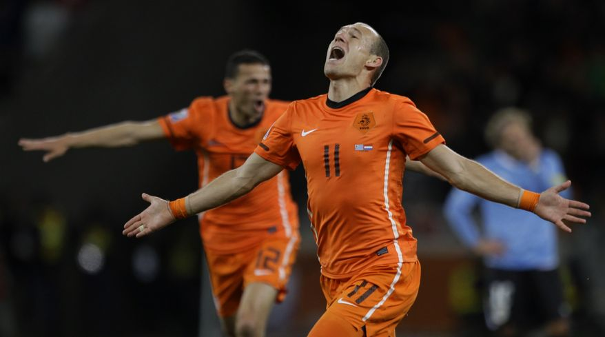 ASSOCIATED PRESS Netherlands' Arjen Robben celebrates after scoring his side's third goal during the World Cup semifinal soccer match between Uruguay and the Netherlands at the Green Point stadium in Cape Town, South Africa, Tuesday, July 6, 2010.