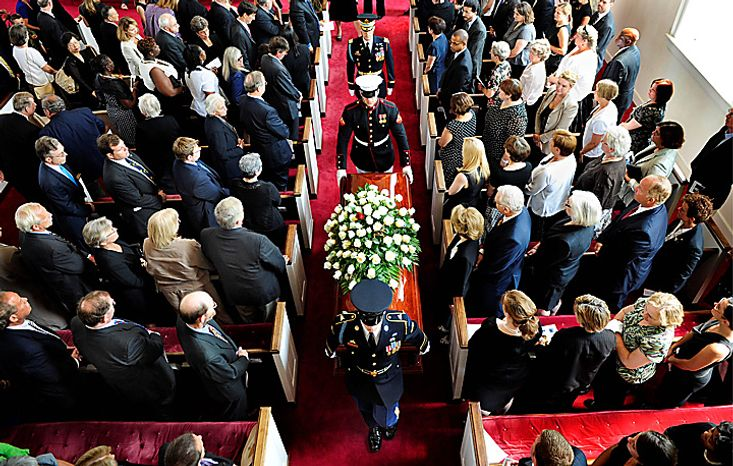 A military honor guard escorts the casket of Sen. Robert Byrd, Tuesday, July 6, 2010,  after a funeral service at the Memorial Baptist Church in Arlington, Va. (AP Photo/Linda Davidson, Pool)