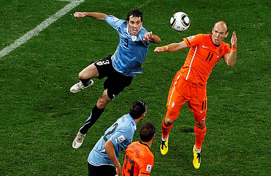 Netherlands' Arjen Robben, right, scores his side's third goal during the World Cup semifinal soccer match between Uruguay and the Netherlands at the Green Point stadium in Cape Town, South Africa, Tuesday, July 6, 2010. The Netherlands won 3-2. (AP Photo/Roberto Candia)