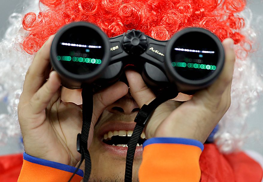 A Dutch soccer fan looks through binoculars prior to the World Cup semifinal soccer match between Uruguay and the Netherlands at the Green Point stadium in Cape Town, South Africa, Tuesday, July 6, 2010.  (AP Photo/Fernando Vergara)