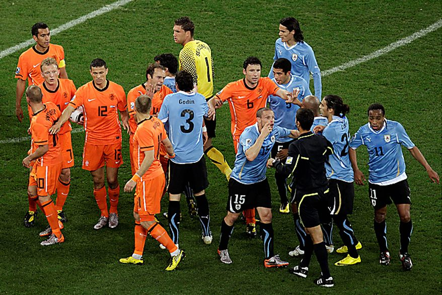 Dutch and Uruguayan players face each other  after Demy de Zeeuw, not visible, was kicked in the face by Uruguay's Martin Caceres, second from right, during the World Cup semifinal soccer match between Uruguay and the Netherlands at the Green Point stadium in Cape Town, South Africa, Tuesday, July 6, 2010.  (AP Photo/Michael Sohn)