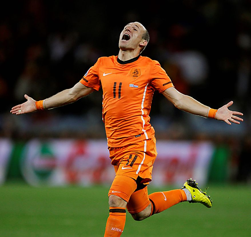 Netherlands' Arjen Robben celebrates after scoring his side's third goal during the World Cup semifinal soccer match between Uruguay and the Netherlands at the Green Point stadium in Cape Town, South Africa, Tuesday, July 6, 2010.  (AP Photo/Julie Jacobson)