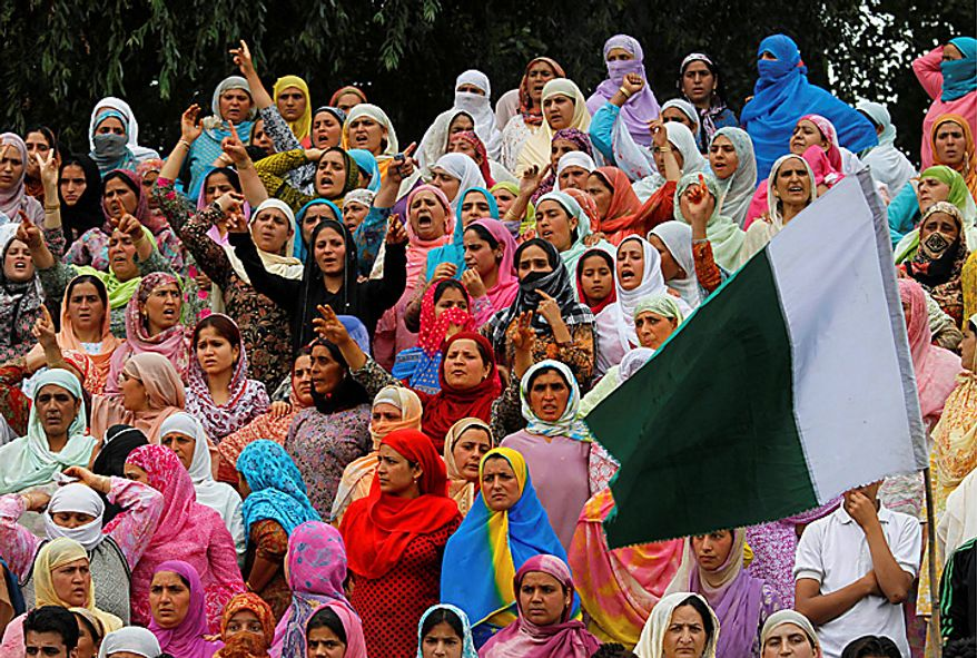 Kashmiris shout freedom slogans during the funeral procession of Muzaffar Bhat and Fayaz Ahamed Wani in Srinagar, India, Tuesday, July 6, 2010. Government forces fired on hundreds of rock-throwing protesters in Indian Kashmir on Tuesday, killing Wani and wounding two others as a seven-day curfew was lifted, locals and officials said. Bhat was allegedly killed by paramilitary soldiers Monday. (AP Photo/Dar Yasin)