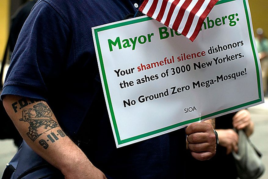 A man attending the protest of the proposed construction of a mosque near ground zero holds a sign directed at New York's Mayor near the World Trade Center site in New York Sunday, June 6, 2010. (AP Photo/Swoan Parker)
