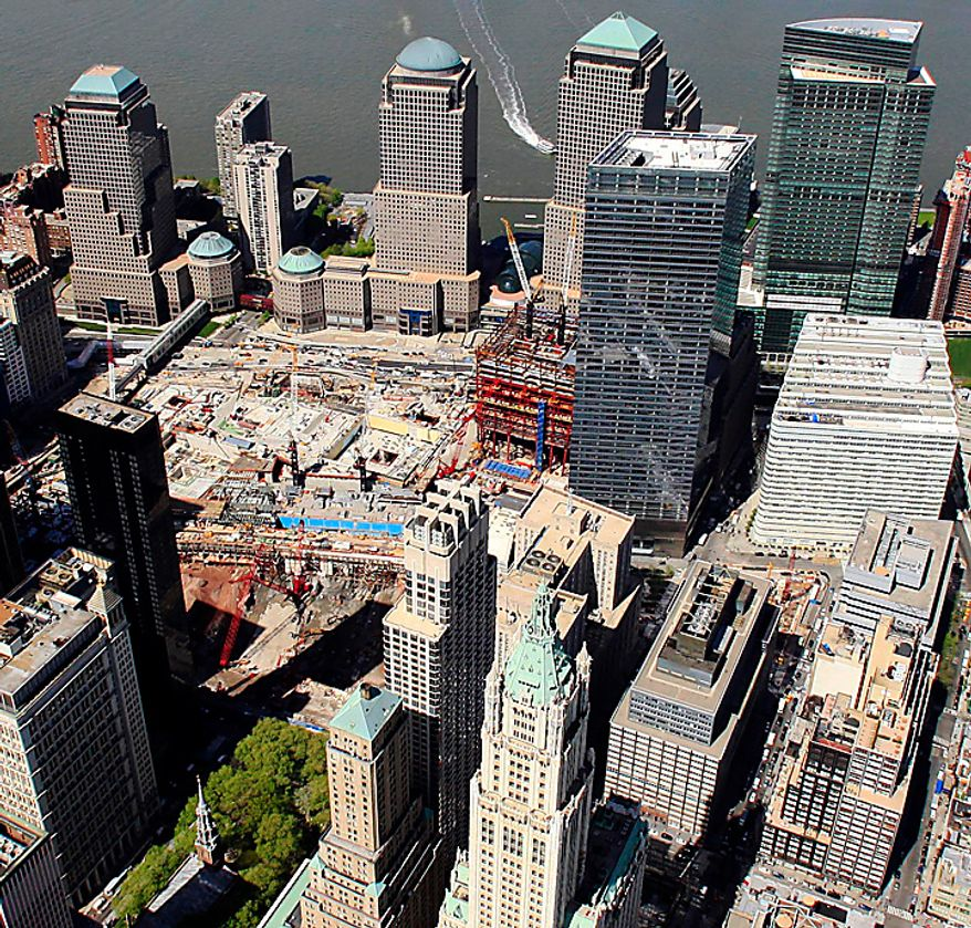 This aerial photo of April 20, 2010, shows the New York city block, lower right, where a 13-story mosque is planned for construction two blocks north of the World Trade Center site, center left. The plan for the $100 million mosque and cultural center received initial support on Wednesday, May  5, 2010, from community board 1 in Lower Manhattan. (AP Photo/Mark Lennihan)