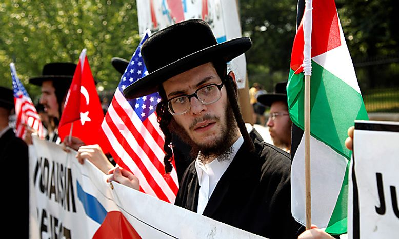 Demonstrators protest the meeting between President Barack Obama and Israeli Prime Minister Benjamin Netanyahu outside of the White House in Washington, Tuesday, July 6, 2010. (AP Photo/Charles Dharapak)