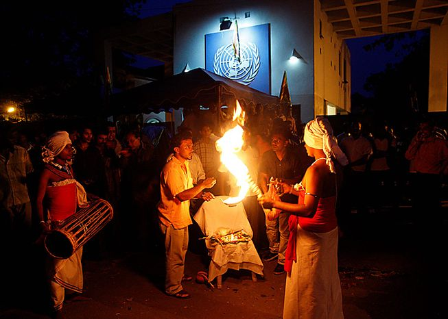 Sri Lankan protesters perform a witchcraft ceremony to curse UN officials outside the UN office during a protest in Colombo, Sri Lanka, Tuesday, July 6, 2010. Police have broken up a blockade of the U.N. office in Sri Lanka's capital and escorted employees out of the office after hundreds of protesters, led by a government minister, laid siege to the U.N. compound in Colombo on Tuesday, and refused to let the workers out until the world body canceled its investigation of alleged abuses committed during Sri Lanka's civil war. (AP Photo/Eranga Jayawardena)