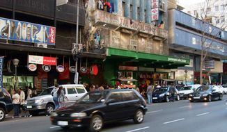 Jeppe Street in downtown Johannesburg is a vivid example of dislocations in the aftermath of apartheid. Many of the derelict buildings are packed with blacks, many of them immigrants, in the hub of Africa's most vibrant economy and democracy. (Associated Press)