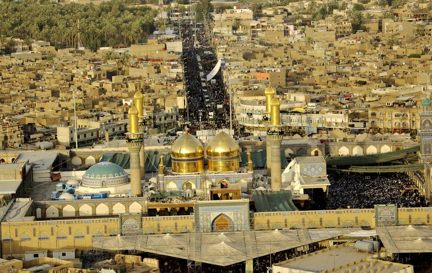 Shi'ite pilgrims gather at the Imam Moussa al-Kadhim shrine for the annual commemoration of the saint's death, in the Shi'ite district of Kazimiyah, in Baghdad, Iraq, Wednesday, July 7, 2010. (AP Photo/Hadi Mizban)