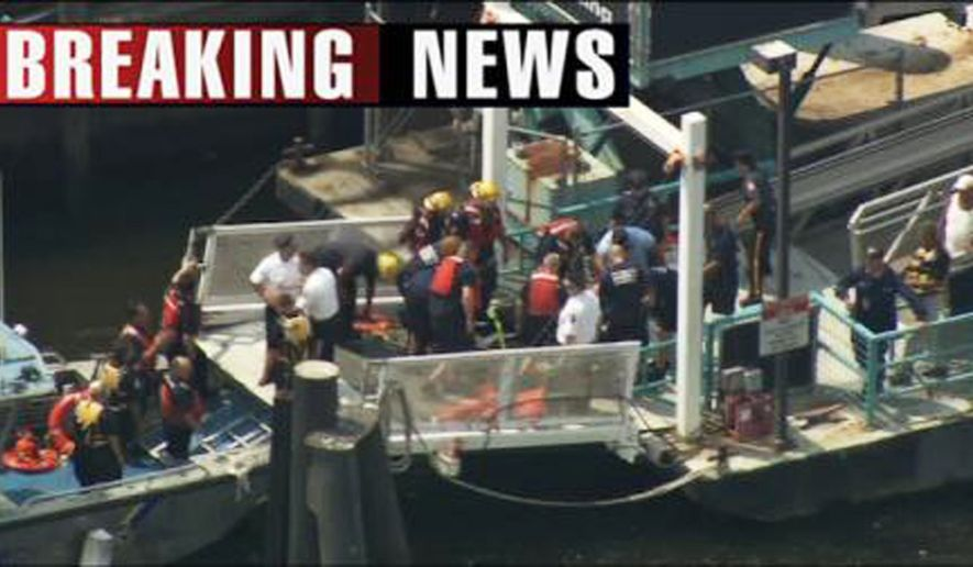 This frame grab provided by WPVI-TV shows rescue efforts underway at the scene on the Delaware River, where a tourist boat overturned after a barge hit it Wednesday, July 7, 2010, in Philadelphia. (AP Photo/WPVI-TV)