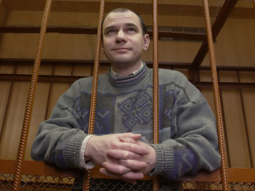 In this Wednesday, April 7, 2004, file picture, Russian arms control researcher Igor Sutyagin stands behind bars as he listens to the verdict as he is sentenced to 15-years in prison for spying, at a courtroom in Moscow. On Wednesday, July 7, 2010, Anna Stavitskaya, Sutyagin's attorney, said, according to Interfax news agency, that Igor Sutyagin could be swapped in exchange for Russians who were arrested recently in the United States suspected of spying for Russia. (AP Photo, file)