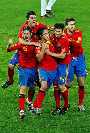 Spain's Carles Puyol, third from left, celebrates after scoring with teammates, from left, Sergio Ramos, David villa, top, Xabi Alonso and Gerard Pique during the World Cup semifinal soccer match between  Germany and Spain at the Moses Mabhida stadium in Durban, South Africa, Wednesday July 7, 2010. (AP Photo/Themba Hadebe)
