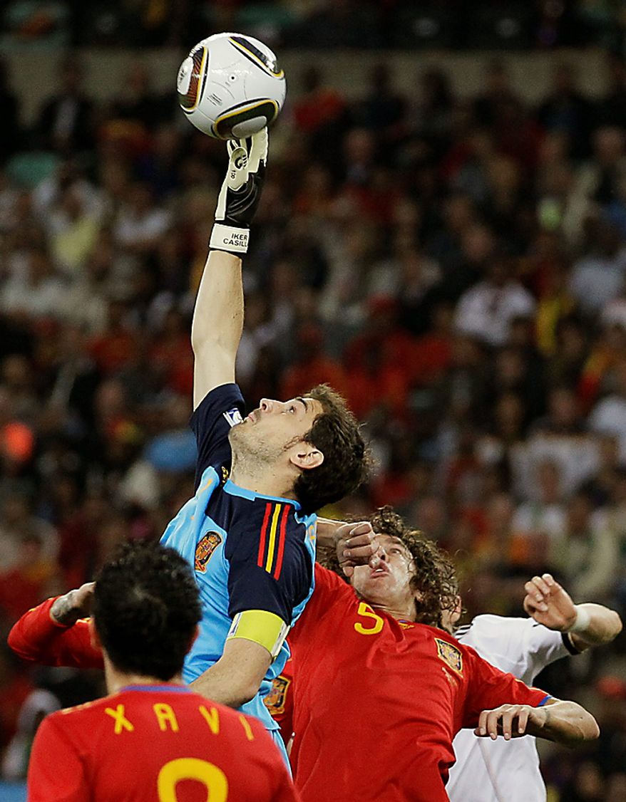 Spain goalkeeper Iker Casillas, center top, makes a save during the World Cup semifinal soccer match between  Germany and Spain at the stadium in Durban, South Africa, Wednesday, July 7, 2010.  (AP Photo/Ivan Sekretarev)