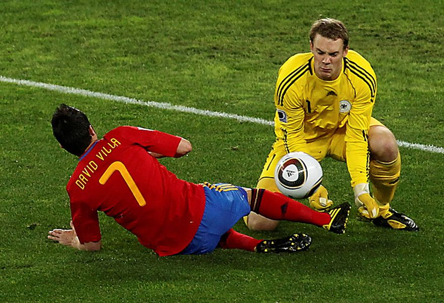 Germany goalkeeper Manuel Neuer, right, saves on Spain's David Villa's shot, during the World Cup semifinal soccer match between  Germany and Spain at the Moses Mabhida stadium in Durban, South Africa, Wednesday July 7, 2010. (AP Photo/Themba Hadebe)
