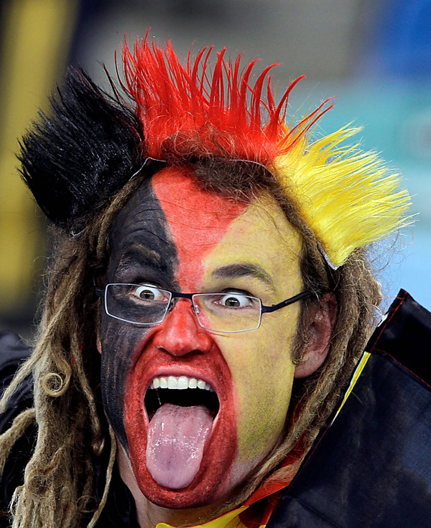 A German fan sticks his tongue out prior to  the World Cup semifinal soccer match between Germany and Spain at the stadium in Durban, South Africa, Wednesday, July 7, 2010.  (AP Photo/Gero Breloer)