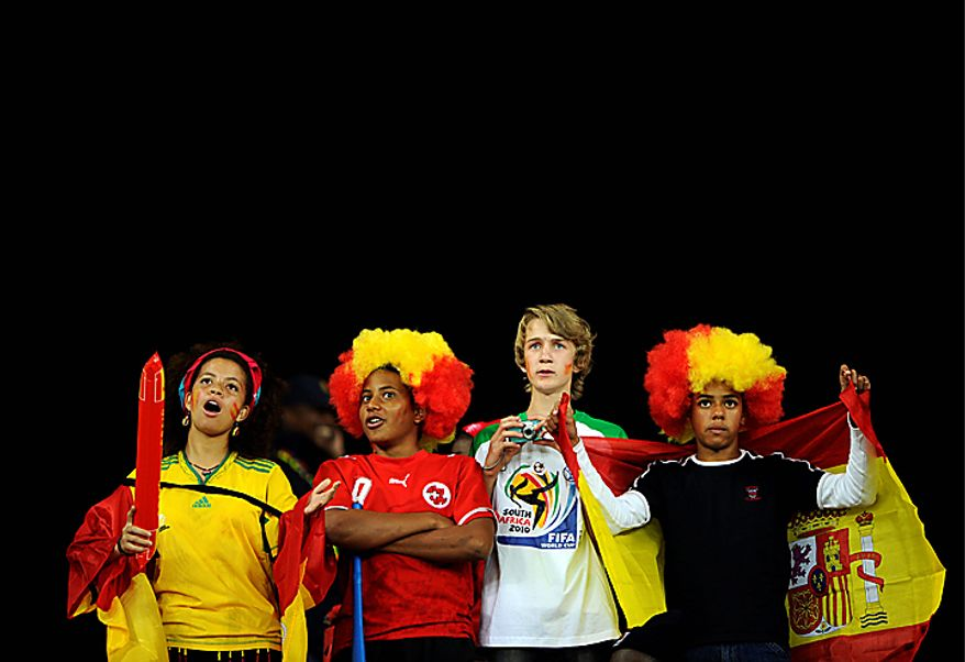 Spain soccer fans wait for the start of  the World Cup semifinal soccer match between  Germany and Spain at the stadium in Durban, South Africa, Wednesday, July 7, 2010.  (AP Photo/Daniel Ochoa de Olza)