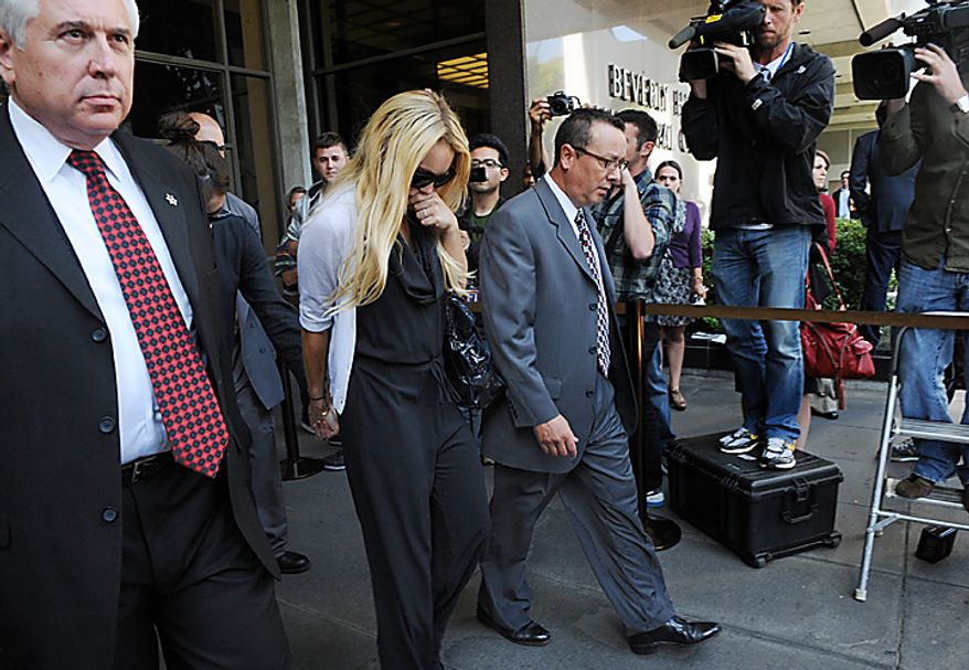 Actress Lindsay Lohan departs the Beverly Hills courthouse following the sentencing by Superior Court Judge Marsha Revel during a probation status hearing in Beverly Hills, California on July 6, 2010. Revel sentenced Lohan to 90 days in jail Tuesday after ruling she violated probation in a 2007 drug case by failing to attend court-ordered alcohol education classes.    UPI/Jim Ruymen