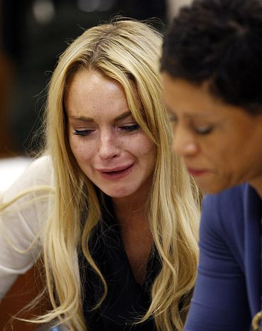 Actress Lindsay Lohan (L) reacts with her attorney Shawn Chapman Holley following the sentencing by Superior Court Judge Marsha Revel during a probation status hearing in Beverly Hills, California on July 6, 2010. Revel sentenced Lohan to 90 days in jail Tuesday after ruling she violated probation in a 2007 drug case by failing to attend court-ordered alcohol education classes.    UPI/David McNew/Pool