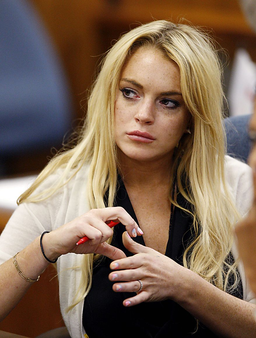 Actress Lindsay Lohan reacts following her sentencing by Superior Court Judge Marsha Revel during a probation status hearing in Beverly Hills, California on July 6, 2010. Revel sentenced Lohan to 90 days in jail Tuesday after ruling she violated probation in a 2007 drug case by failing to attend court-ordered alcohol education classes.    UPI/David McNew/Pool