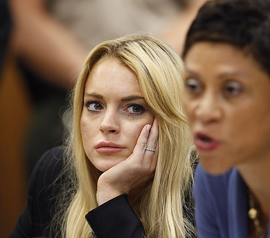 Actress Lindsay Lohan (L) and attorney Shawn Chapman Holley appear in court during a probation status hearing relating to her August 2007 no contest pleas to two counts each of DUI and being under the influence of cocaine, along with a reckless driving charge, at the Beverly Hills Municipal Courthouse, in Beverly Hills, California on July 6, 2010.      UPI/David McNew/Pool