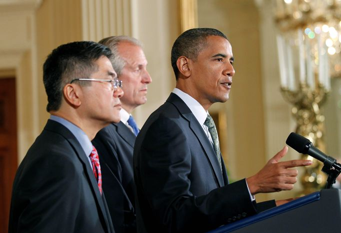 President Barack Obama, right, with Boeing President, Chairman and CEO Jim McNerney, Jr., center, and Commerce Secretary Gary Locke, left, speaks about exports, jobs and the economy on Wednesday, July 7, 2010, in the East Room of the White House in Washington. (AP Photo/Pablo Martinez Monsivais)