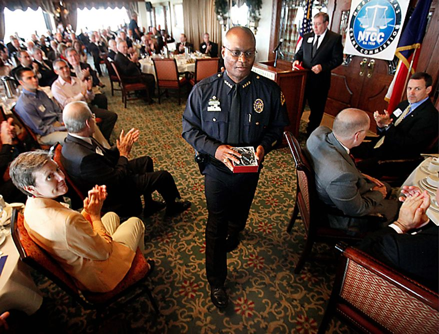 Dallas Police Chief David Brown receives a round of applause after addressing a breakfast meeting Wednesday July 7, 2010 of the North Texas Crime Commission at the Park Cities Club, in Dallas. Brown is resuming his public duties more than two weeks after his son was killed. An autopsy found that David Brown Jr. had marijuana and PCP in his system when he fatally shot Lancaster police Officer Craig Shaw and neighbor Jeremy McMillan on June 20. The Father's Day shootings took place during a domestic dispute at an apartment complex. Officers returned fire and killed Brown Jr. (AP Photo/The Dallas Morning News, Jim Mahoney)