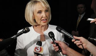 ** FILE ** In this June 15, 2010 file photo, Arizona Gov. Jan Brewer speaks in Phoenix. Donations to a special fund that Arizona Gov. Jan Brewer established to help pay for the state's legal defense of its immigration enforcement law now total roughly $500,000. (AP Photo/Ross D. Franklin, File )