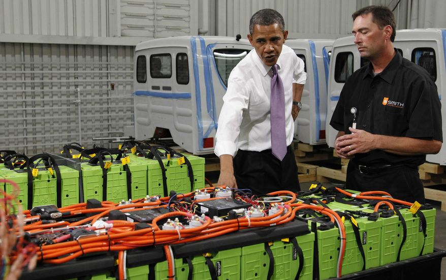 President Barack Obama listens to Dennis Hartman as they look at rechargeable car batteries during his tour of Smith Electric Vehicles in Kansas City, Mo., Thursday, July 8, 2010. (AP Photo/Pablo Martinez Monsivais)
