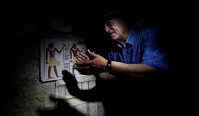 Egyptian Antiquities chief Zahi Hawass shows to the media the false door of the unearthed 4,300-year-old tomb that belongs to Khonsu the son of Shendwas, both of whom served as heads of the royal scribes during the Old Kingdom, in Saqqara near Cairo, Egypt, Thursday, July 8, 2010. (AP Photo/Nasser Nasser)