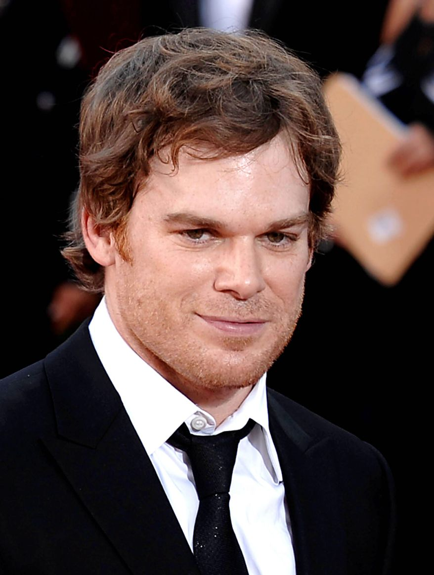"In this Sept. 20, 2009, file photo, actor Michael C. Hall arrives at the 61st Primetime Emmy Awards in Los Angeles. Hall was nominated for an Emmy for best actor in a drama series on Thursday, July 8, 2010, for his role in ""Dexter."" The 62nd Primetime Emmy Awards will be held on Sunday, Aug. 29, in Los Angeles. (AP Photo/Chris Pizzello, file)"
