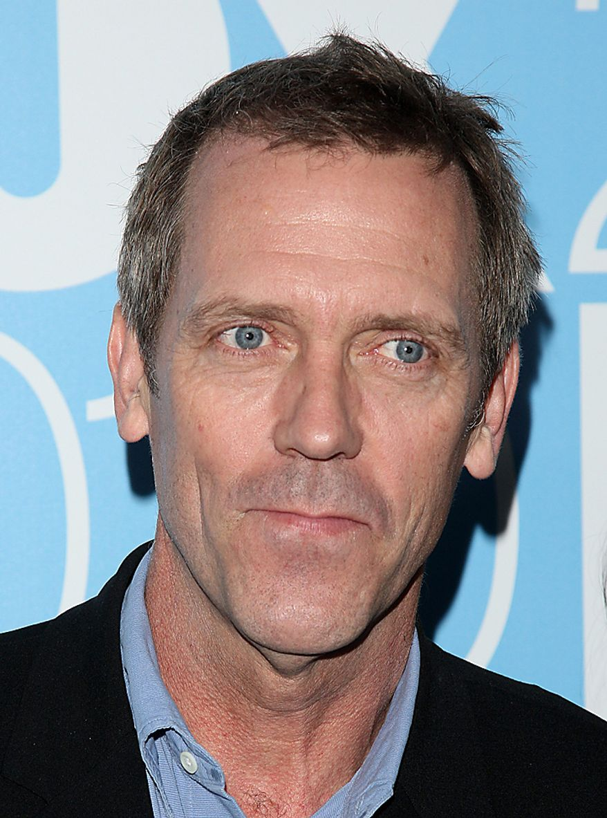 "In this May 17, 2010, file photo, actor Hugh Laurie attends the FOX Upfront presentation in New York. Laurie was nominated for an Emmy for best actor in a drama series on Thursday, July 8, 2010, for his role in ""House."" The 62nd Primetime Emmy Awards will be held on Sunday, Aug. 29, in Los Angeles. (AP Photo/Peter Kramer, file)"