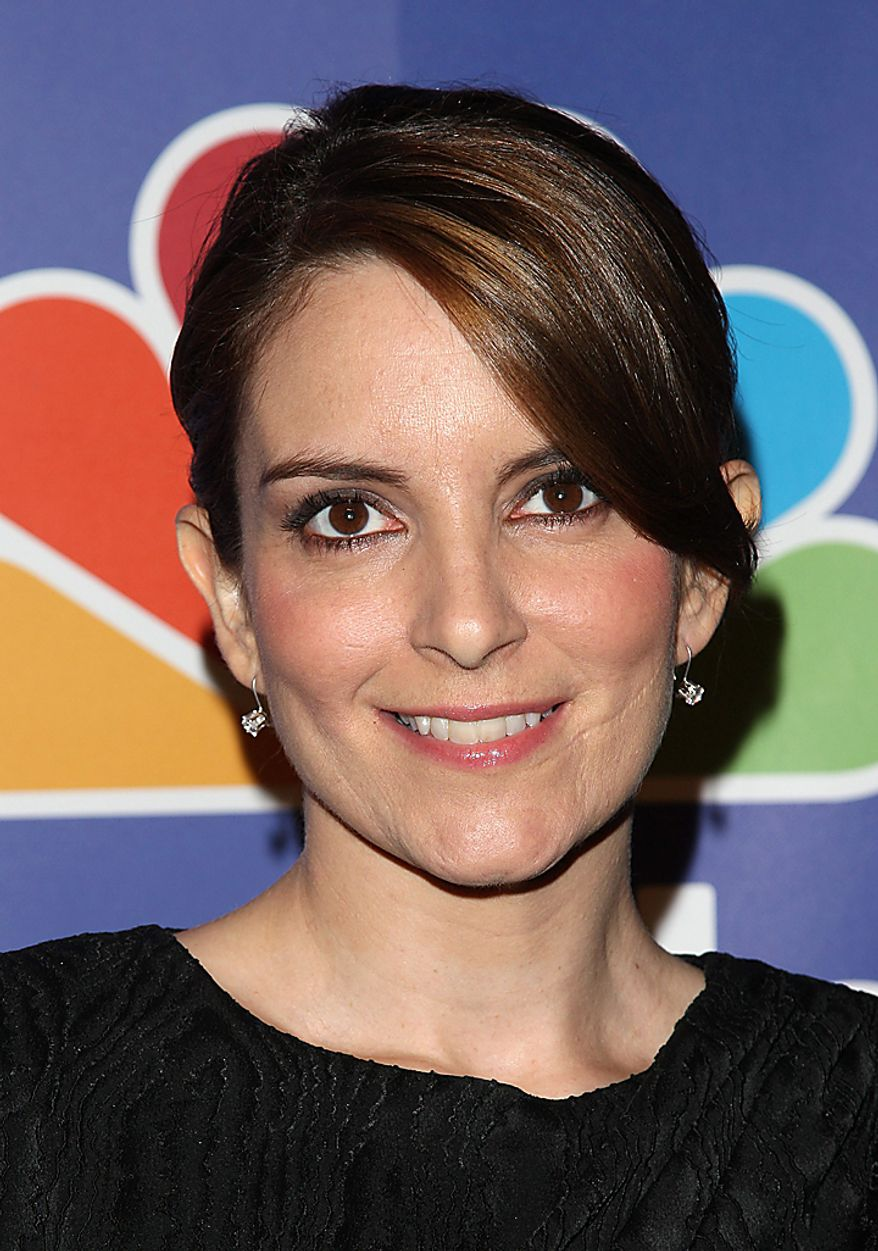"In this May 17, 2010, file photo, actress Tina Fey attends the NBC Universal's Upfront presentation in New York. Fey was nominated for an Emmy for best actress in a comedy on Thursday, July 8, 2010, for her role in ""30 Rock."" The 62nd Primetime Emmy Awards will be held on Sunday, Aug. 29, in Los Angeles. (AP Photo/Peter Kramer, file)"