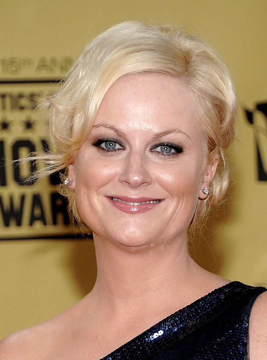 "In this Jan. 15, 2010, file photo, Amy Poehler arrives at the 15th Annual Critics Choice Movie Awards in Los Angeles. Poehler was nominated for an Emmy for best actress in a comedy series on Thursday, July 8, 2010 for her role in ""Parks and Recreation."" The 62nd Primetime Emmy Awards will be held on Sunday, Aug. 29, in Los Angeles. (AP Photo/Dan Steinberg, file)"