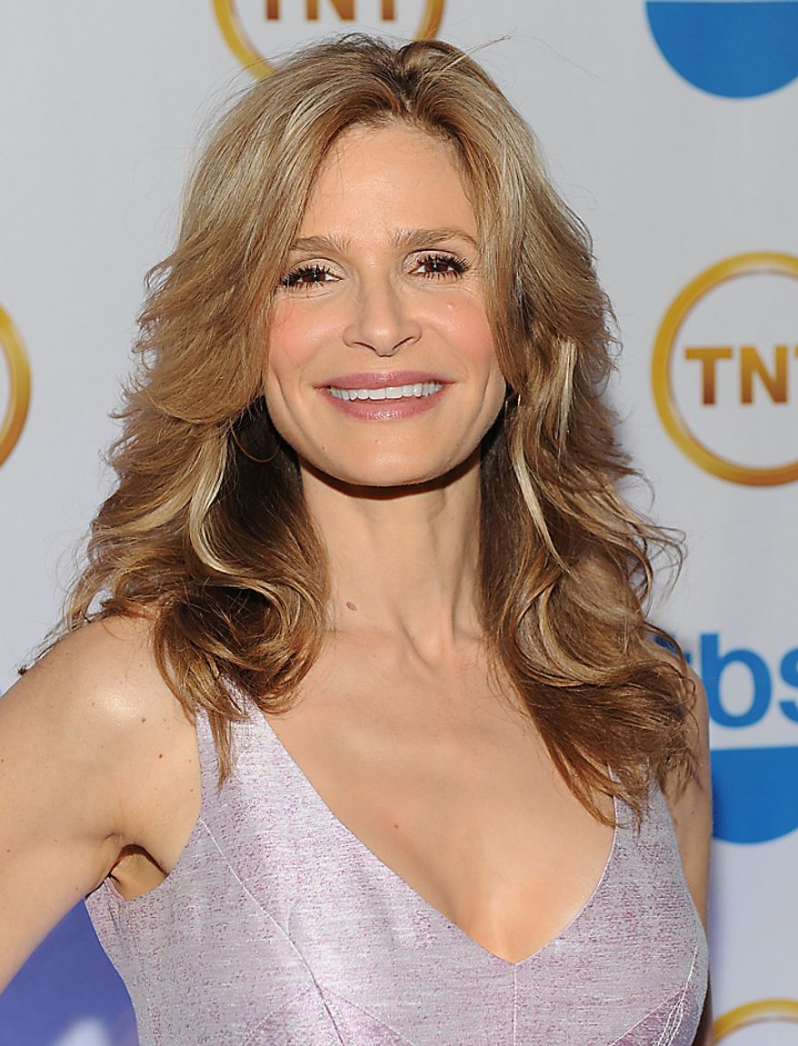 """In this May 19, 2010, file photo, actress Kyra Sedgwick attends the TNT and TBS Upfront presentation in New York. Sedgwick was nominated for an Emmy on Thursday, July 8, 2010, for best actress in a drama series for her role in """"The Closer."""" The 62nd Primetime Emmy Awards will be held on Sunday, Aug. 29, in Los Angeles.  (AP Photo/Evan Agostini, file)"""