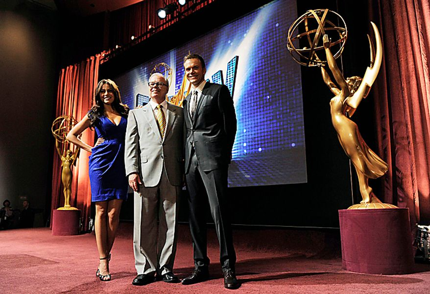 Actors Sofia Vergara, left, and Joel McHale, right, pose with Television Academy Chairman and CEO John Shaffner after they announced the nominations for the 62nd Primetime Emmy Awards at the Academy of Television Arts & Sciences  in Los Angeles, Thursday, July 8, 2010. The show will be held on Aug. 29 at the Nokia Theatre in Los Angeles. (AP Photo/Chris Pizzello)