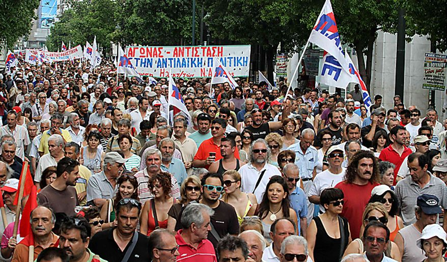 Protesters take part in a rally in central Athens,Greece, Thursday, July 8, 2010. More than 12,000 people took part in two separate protest marches, according to police estimates. Greece's governing Socialists are battling growing discontent as a new round of economic austerity faces party dissent, growing public hostility and fresh strike.(AP Photo/Alkis Konstantinidis)