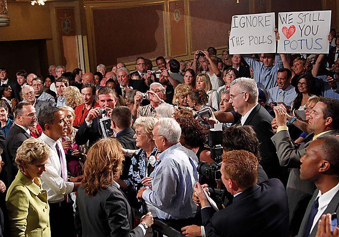 President Barack Obama greets supporters at a campaign rally for Missouri Senate hopeful Robin Carnahan, far left, Thursday, July 8, 2010, in Kansas City, Mo. (AP Photo/Pablo Martinez Monsivais)