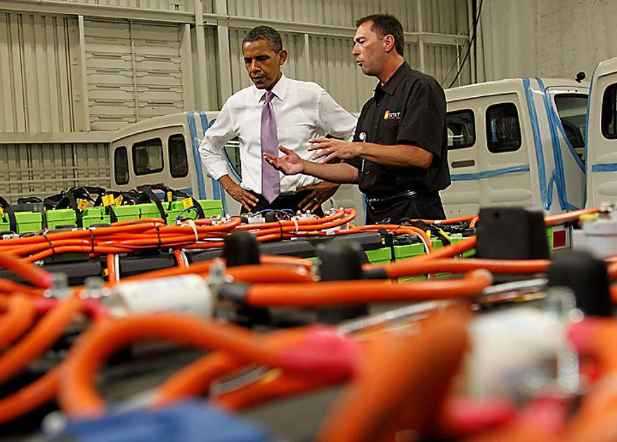 President Barack Obama listens to Dennis Hartman during his tour of Smith Electric Vehicles in Kansas City, Mo., Thursday, July 8, 2010. (AP Photo/Pablo Martinez Monsivais)
