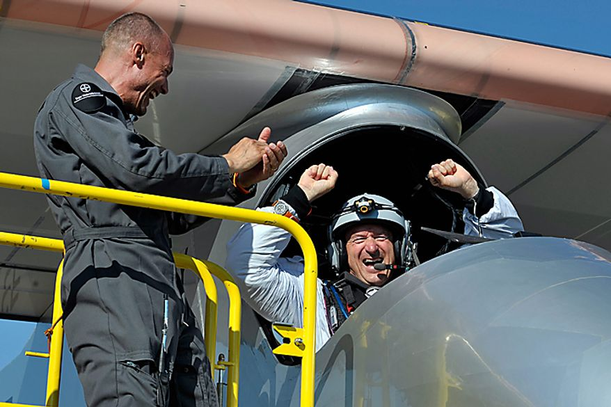 Solar Impulse's team chief Bertrand Piccard, left, and Solar Impulse's Chief Executive Officer and pilot Andre Borschberg celebrate after successfully landing the solar-powered HB-SIA prototype airplane after its first successful night flight attempt at Payerne airport, Switzerland, on Thursday, July 8, 2010. The aircraft took off July 7 at 06:51 a.m. and reached an altitude of 28,543 feet by the end of the day. It then slowly descent to 4,921 feet and flew during the night on the batteries, charged during the day by 12,000 solar cells, which powered the four electric motors. It landed July 8 at 09.00 a.m. for a flight time of 26 hours 9 minutes setting the longest and highest flight ever made by a solar plane. (AP Photo/Keystone, Dominic Favre, Pool)