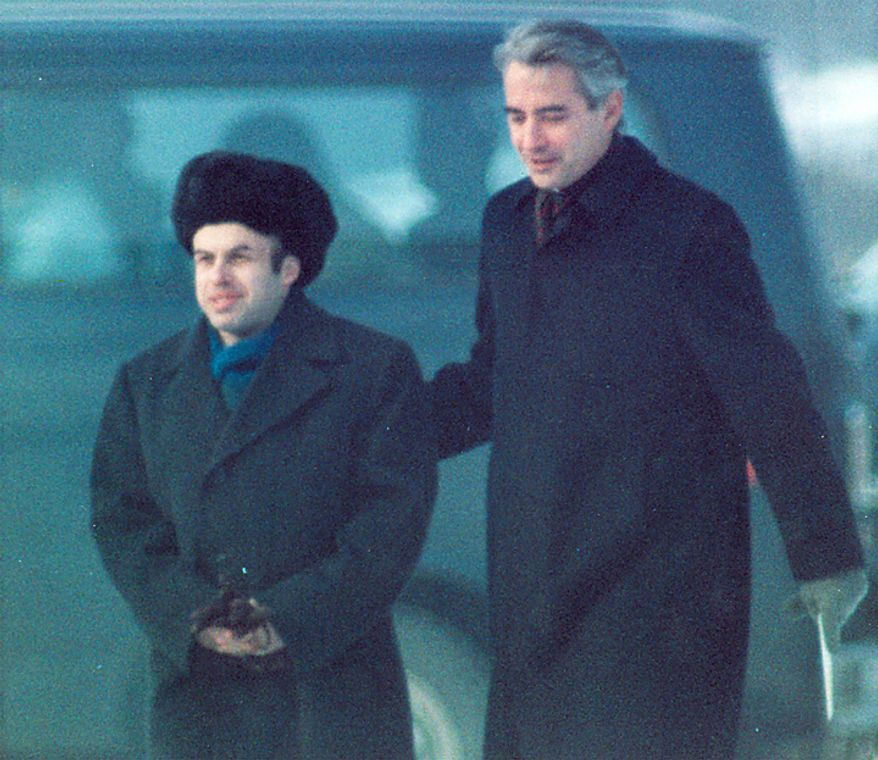 In this Feb. 11, 1986 file photo, Soviet Jewish dissident Anatoly B. Shcharansky, left, is escorted by U.S. Ambassador Richard Burt after Shcharansky crossed the border between East Germany and West Berlin at Glienicke Bridge during an East-West spy and prisoner exchange. (AP Photo/File)