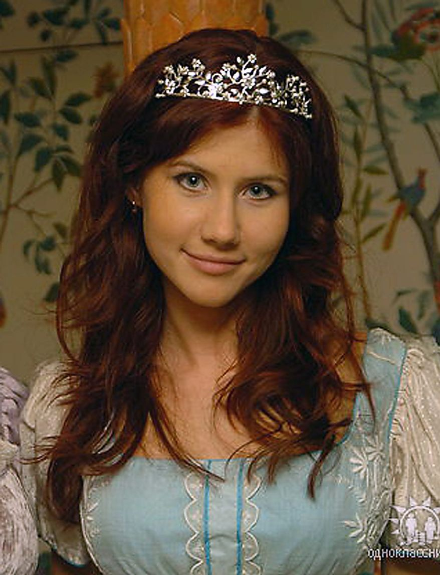 """This undated file image taken from the Russian social networking website """"Odnoklassniki"""", or Classmates, shows a woman journalists have identified as Anna Chapman, who appeared at a hearing Monday, June 28, 2010 in New York federal court. Chapman, along with 10 others, was arrested on charges of conspiracy to act as an agent of a foreign government without notifying the U.S. attorney general. The caption on Odnoklassniki reads """"Russia, Moscow. London, Stone age."""" (AP Photo, File)"""