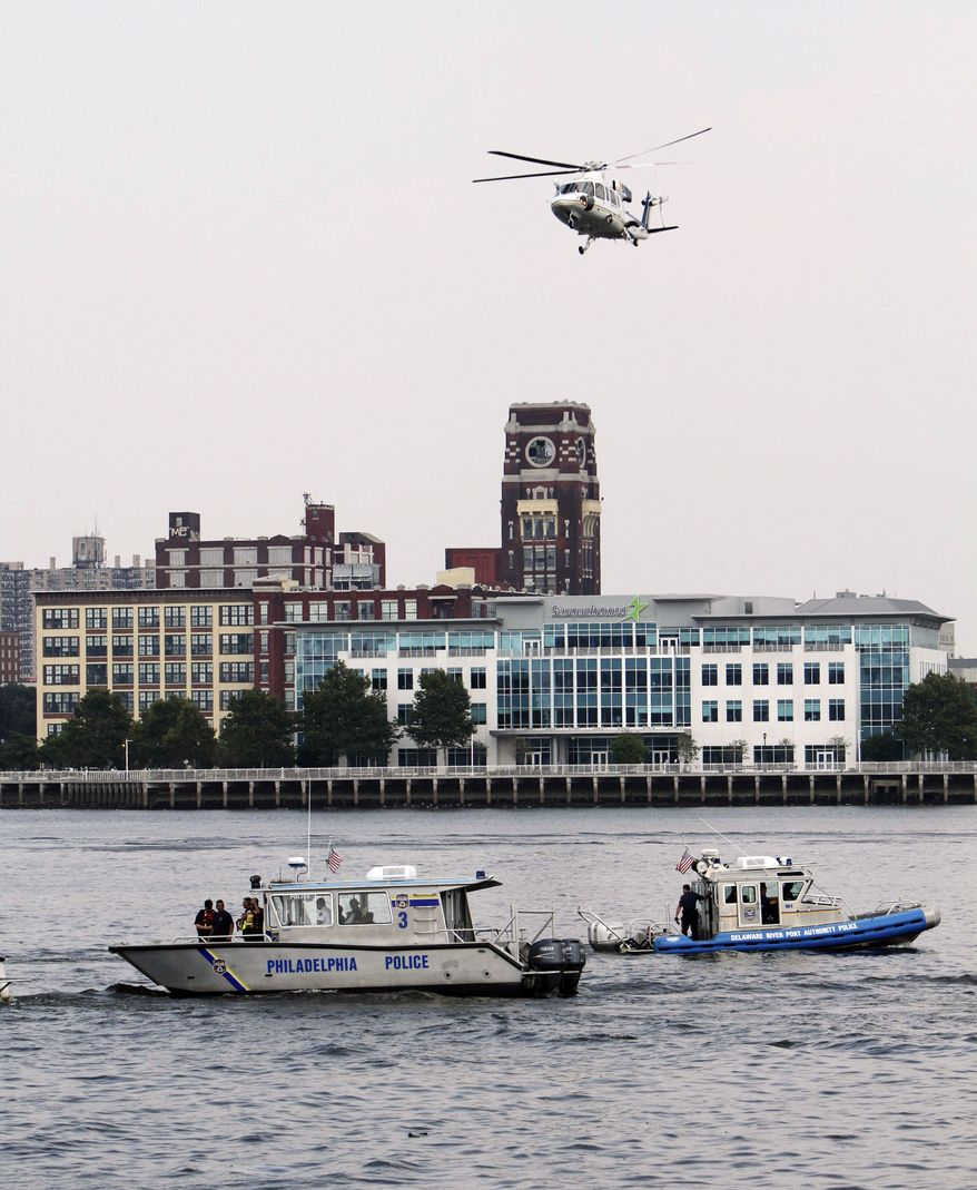 Rescue vessels are seen on the Delaware River in Philadelphia, Wednesday, July 7, 2010. Coast Guard officials say a barge collided with a tourist duck boat on the Delaware River in Philadelphia. (AP Photo/ Joseph Kaczmarek)
